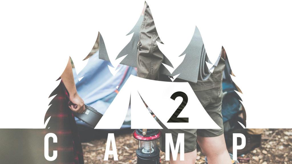 holding lantern while camping in ventura