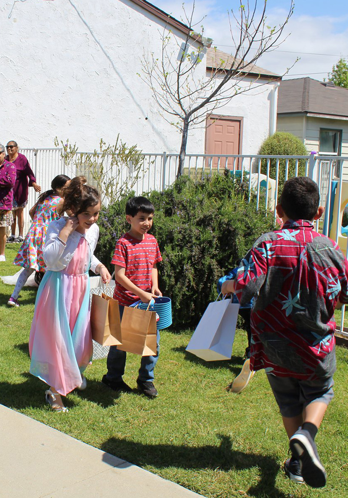 kids looking for easter eggs at church in ventura