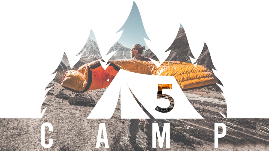Man standing on mountain in ventura with sleeping bag
