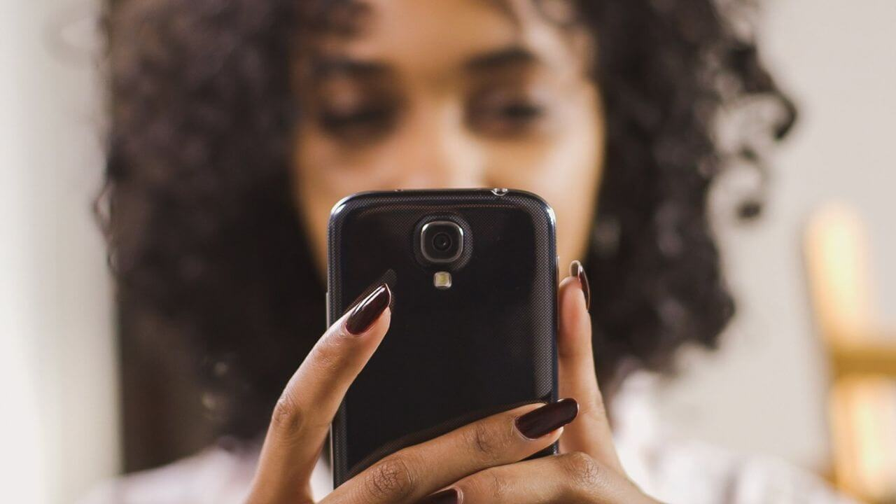 Young woman contacting the Church on her phone