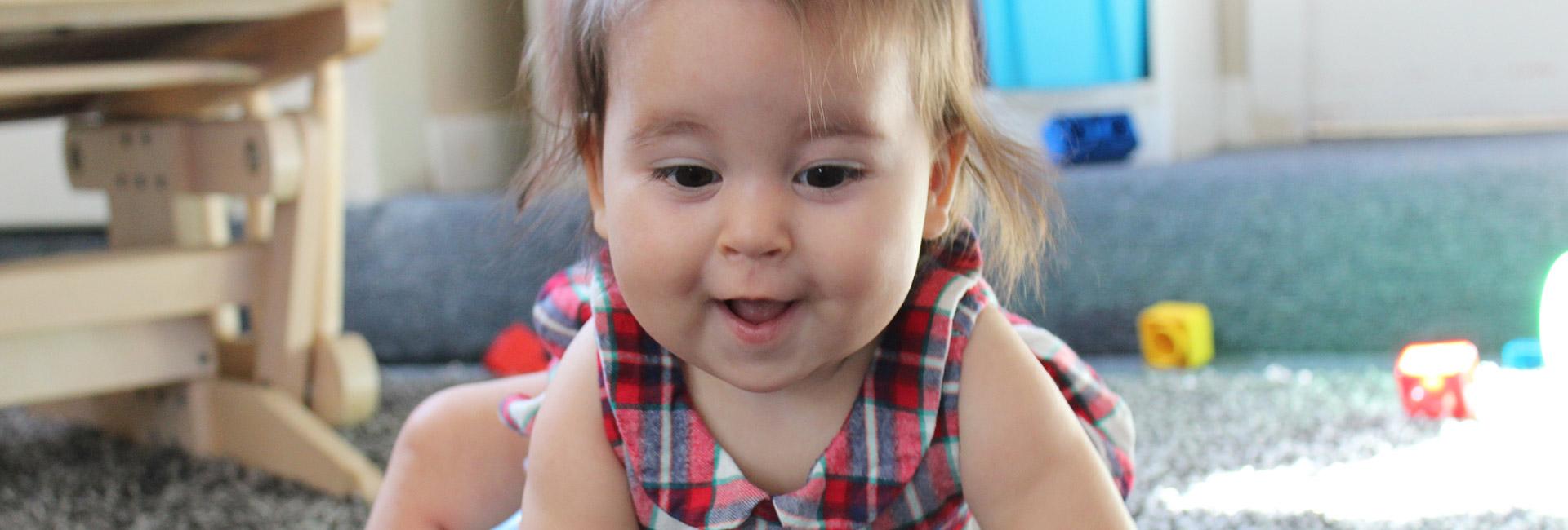 Baby in Church nursery crawling