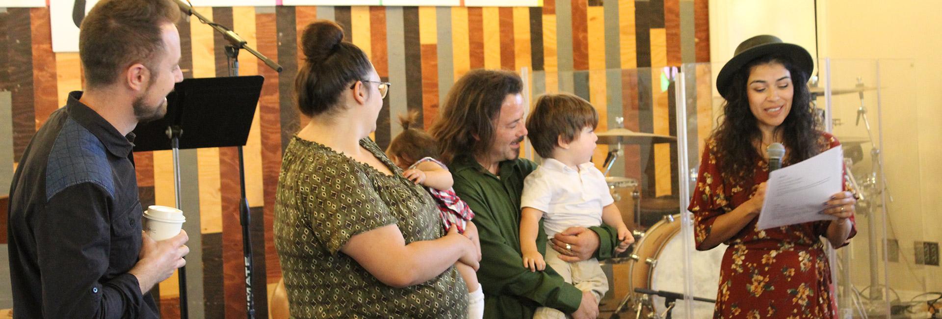 Pastor dedicating child in Ventura Church