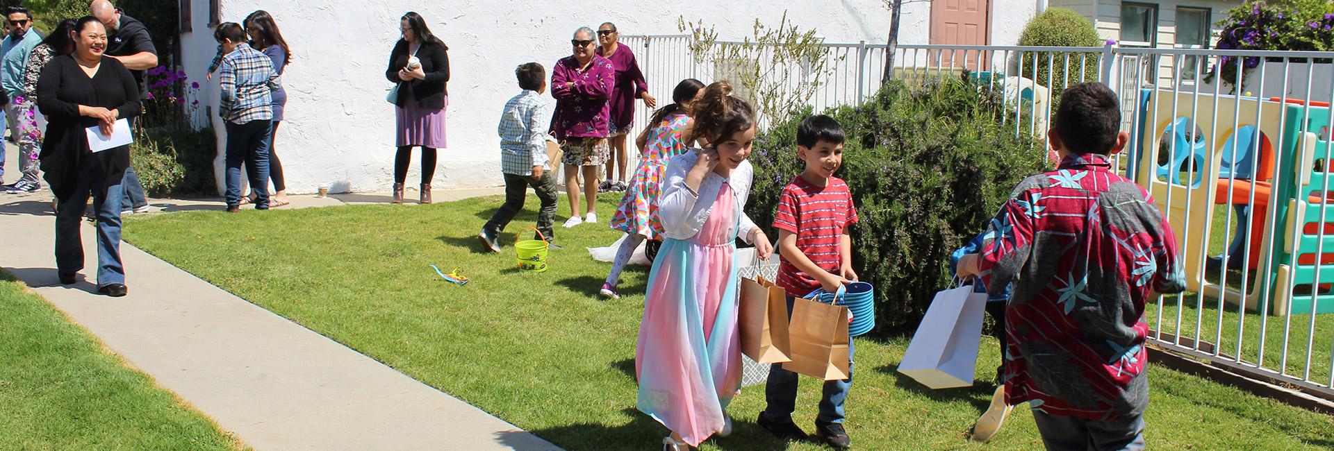 Kids running to get Easter eggs in Ventura