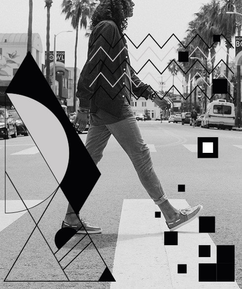Curly hair man walking down main street in Ventura