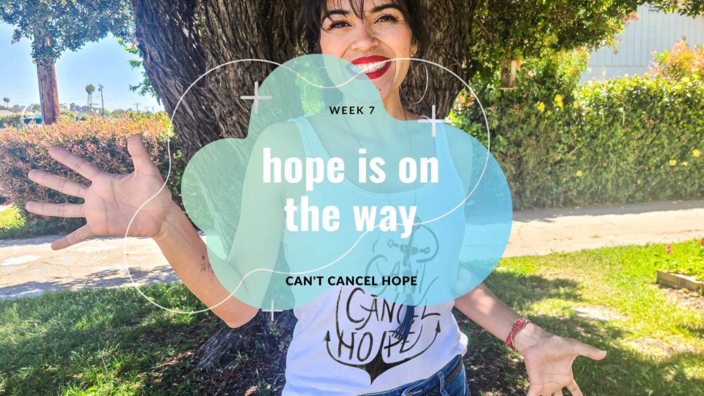 Girl standing in Ventura with white tank top and with hope is on the way