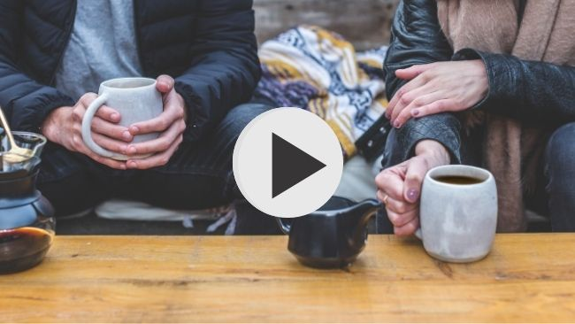 couple drinking coffee listening to church